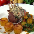 Roast Rack of Lamb with Herb Crust, Courgettes, Tomatoes and Mini Fondant Potatoes