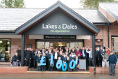 Staff, customers and local school children help open the store
